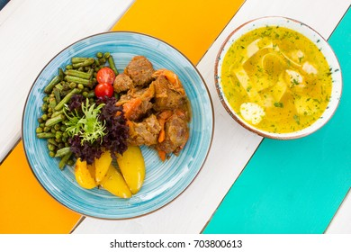 Healthy vegetables with meat on the plate with soup in the restaurant