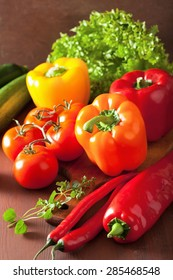 healthy vegetables pepper tomato salad chilli on rustic background
