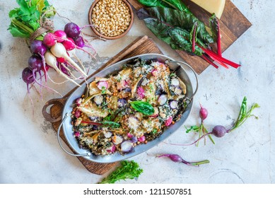 Healthy vegetarian baked roasted vegetable dish gratin with radish, chard and fennel