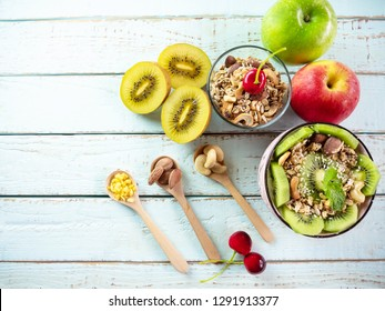 Healthy vegetarian breakfast bowls various cereals, seeds, beans and grains ,smoothie with kiwi and strawberry which clean eating, diet food concept