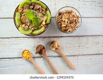 Healthy vegetarian breakfast bowls various cereals, seeds, beans and grains ,smoothie with kiwi  which clean eating, diet food concept