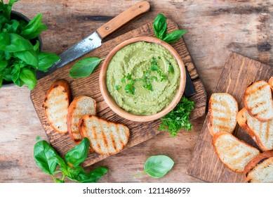 Healthy vegetarian dish basil green hummus, snack or appetizer