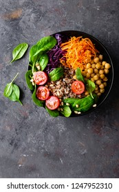 Healthy vegetarian dish with buckwheat and vegetable salad of chickpea, kale, carrot, fresh tomatoes, spinach leaves and pine nuts. Buddha bowl. Balanced food. Delicious detox diet.Top view