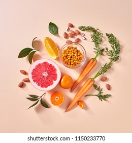 Healthy vegetarian food - orange organic vegetables and fruits on a paper background. Top view. Concept of organic natural vegetarian food.