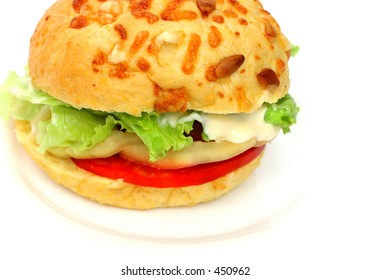Healthy vegetarian hamburger with wholegrain bread and lot of fresh vegetables