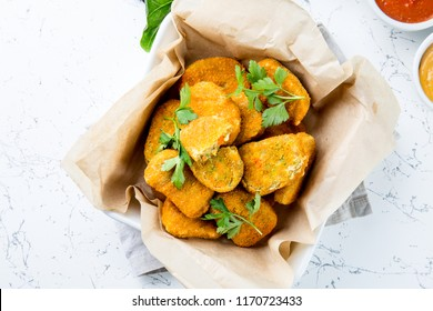 Healthy vegetarian nuggets with carrots, cauliflower and spinach. Vegetable nuggets. Vegan food. Top view, white background.