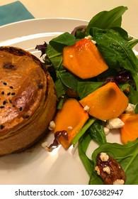 Healthy vegetarian pie with fresh salad, closeup