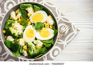 Healthy vegetarian salad with eggs, broccoli, corn and cheese