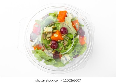Healthy vegetarian salad in plastic package  for take away or food delivery isolated on a white background.