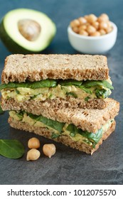 Healthy vegetarian sandwich with avocado, chickpeas and spinach