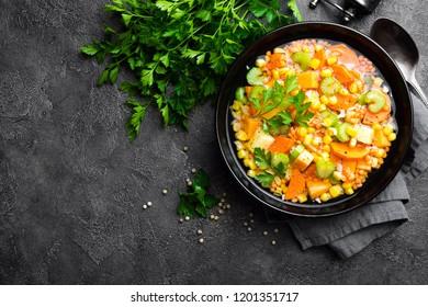 Healthy vegetarian vegetable soup with lentil and vegetables. Lentil soup with vegetables