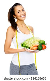 Healthy vegetarian woman showing a plate of vegetables and smiling isolated on white background