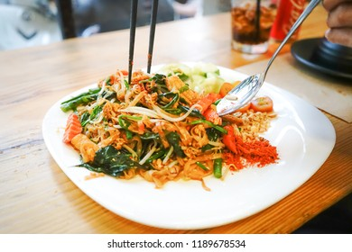Healthy Vegetarian/vegan menu; Padthai noodle with smoke tofu and mixed vegetable - sprout, carrot, garlic chive, shallot and radish) with crushed peanut, sunflowers, pumpkin seeds and dried raisin