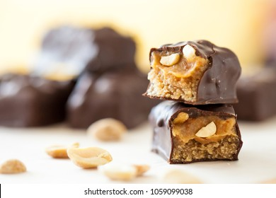 Healthy version of chocolate bars with peanuts and dates filling
