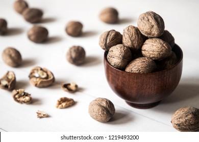 healthy wallnuts in woooden bowl