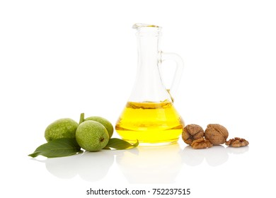 Healthy walnut oil with wallnuts isolated on white background. Healthy oil background.