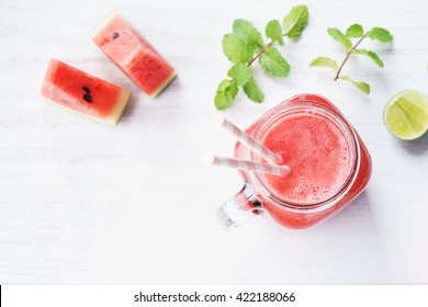 Healthy watermelon drink and fresh watermelon on white background