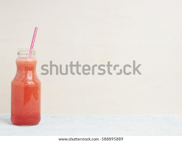 Healthy watermelon strawberry smoothie with paper straw. Simple vegetarian food background. Detox. Text space. Horizontal.