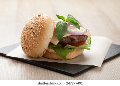 Healthy wheat sandwich burger with beef steak, cheese, tomato, lettuce, onion, basil and ketchup  served for eating