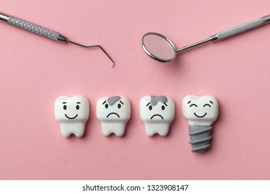Healthy white teeth and implant are smiling and the tooth is sick with caries sad on pink background. Dentist tools mirror, hook