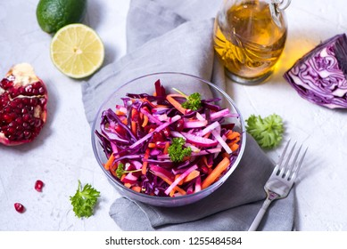 Healthy winter salad with red cabbage, carrot, beetroot, pomegranate, vegan vitamin food