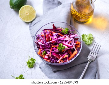 Healthy winter salad with red cabbage, carrot, beetroot, apple, vegan vitamin food