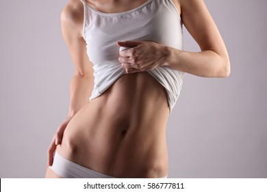 Healthy woman body, waistline. Slim female torso, waist, belly, abdomen close up. Sport, fitness, Dieting results, laser lipolysis, active lifestyle concept