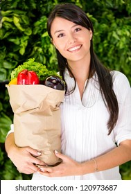 Healthy woman buying fresh food at the local market