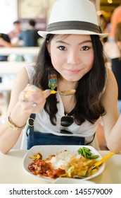 Healthy woman enjoy eating food on the table in restaurant