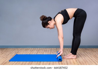 Healthy woman exercising yoga at sport gym, girl doing sport indoor.Photo design for fitness sporty woman and healthcare concept.