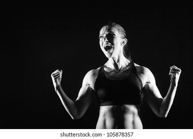 Healthy Woman Fitness enjoys success with his hands up. Black and white photo