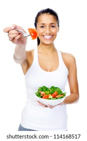 Healthy woman happy on diet eating an organic vegan or vegetarian salad as a snack isolated on white background