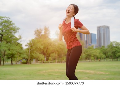 healthy woman jogging daily morning, exercise in city park alone