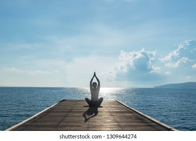 Healthy woman lifestyle balanced practicing meditate and zen energy yoga on outdoors the bridge in morning. Healthy life Concept.