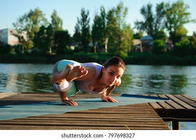 Healthy woman lifestyle balanced practicing meditate and energy yoga on the bridge in morning the nature. Healthy Concept.