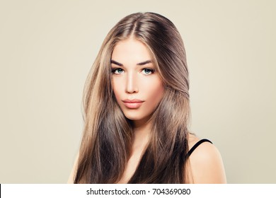Healthy Woman with Perfect Skin and Long Brown Hair. Young Beauty
