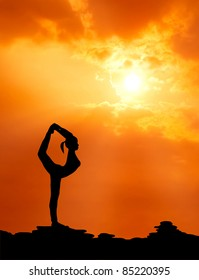 healthy woman  practice yoga at sunset silhouetted