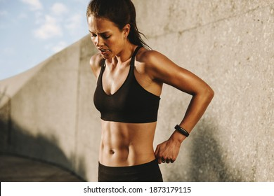 Healthy woman relaxing after workout. Female taking a breather from workout.