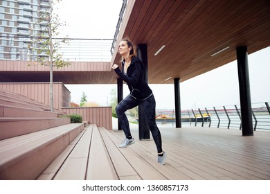 Healthy woman running and climbing up on stairs