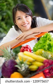 Healthy woman shopping for groceries at the supermarket