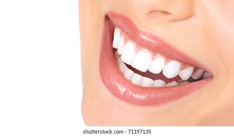 Healthy woman teeth and smile. Close up.