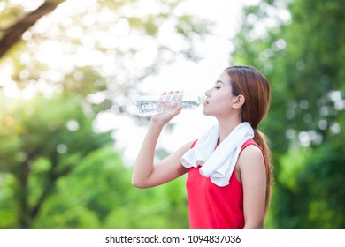 Healthy women Runner have a Handkerchief on the shoulder Drinking water,Female sporty model or athlete after work out.fitness sport concept.