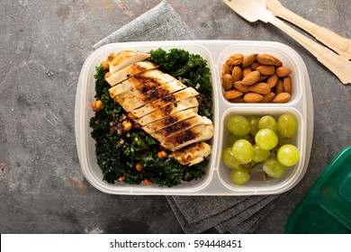 Healthy work or school lunch with grilled chicken, kale and quinoa