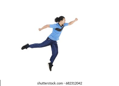 Healthy young African man running in the studio while wearing sportswear, isolated on white background