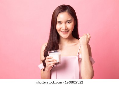 Healthy Young Asian woman drinking  milk   on pink background