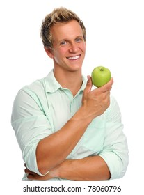 Healthy young caucasian man is about to eat a green apple