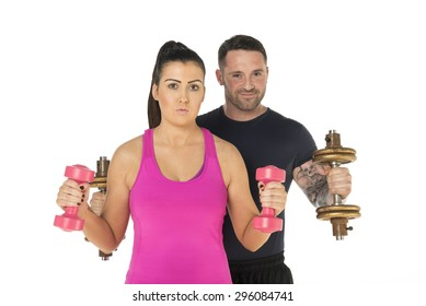 Healthy young couple standing with dumbbells close up