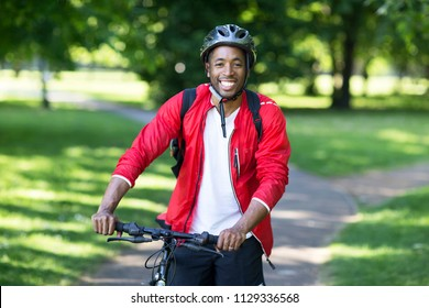 healthy young man with his bike outdoors.