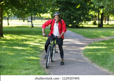 healthy young man with his bike in the park