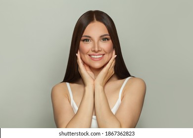 Healthy young woman with clear skin smiling. Skincare, spa and facial treatment concept